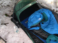 The North Face storm proof Soloist Bivy, classic Blue Kazoo 20 degree down bag, ThermaRest Guide-Lite three quarter pad and RidgeRest pad and Platypus one litre water bag.
